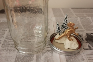 Mason Jar Snow Globes with Gold Dinosaurs